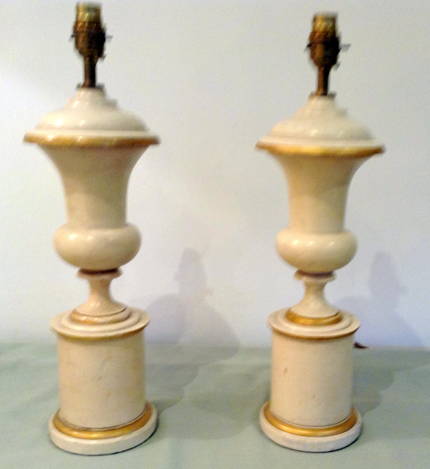 Cream and gilt wooden urns